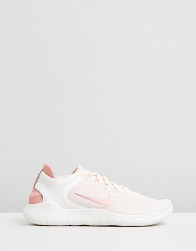 "<a href=""https://www.theiconic.com.au/free-run-2018-women-s-584068.html"" target=""_blank"" title=""Nike Free Run 2018 in Guava Ice, Rust Pink and Pink Tint, $170"" draggable=""false"">Nike Free Run 2018 in Guava Ice, Rust Pink and Pink Tint, $170</a>"