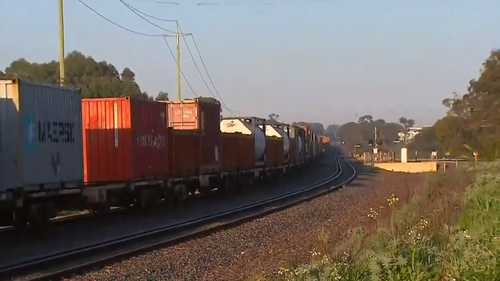 A cargo train has crashed into a car in Bibra Lake, in Perth's south this morning.