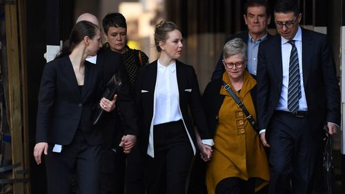Actor Eryn Jean Norvill (centre) arrives at the Federal Court in Sydney, Wednesday, October, 31, 2018.