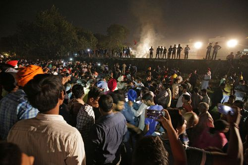 A speeding train has ran over a crowd watching fireworks during a religious festival in northern India, killing at least 58 people and injuring dozens more, police said.