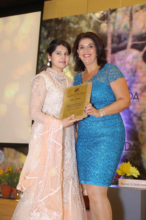 Shar Moore (right) with Dr Harbeen Arora being awarded the Woman of the Decade in Personal Leadership in New Delhi in May this year. Picture: Supplied