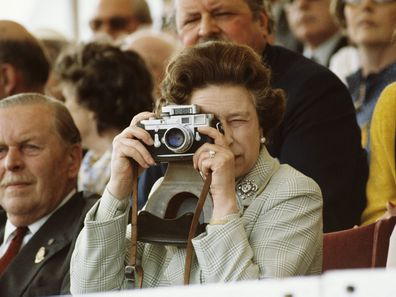 Queen Elizabeth taking photos with a Leica camera