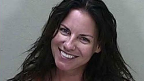 A woman seen smiling in a mugshot after being arrested following a car crash has been charged with manslaughter. (Marion County Jail)