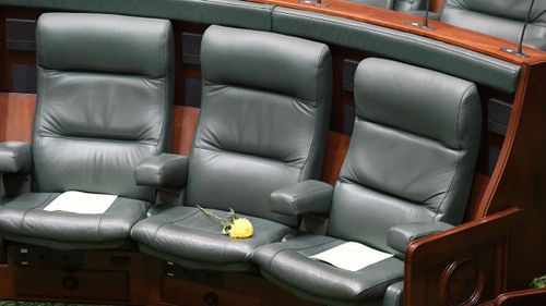 A yellow flower is placed on the seat of Victorian MP Fiona Richardson last Thursday. (AAP)