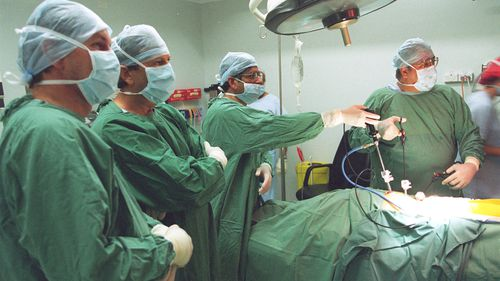 Doctors at the Holroyd Private Hospital in 1997 carry out the mesh repair of a hernia in the groin.