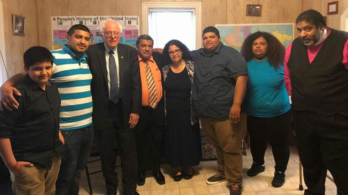 Jose Chicas (fourth from left) with Senator Bernie Sanders.