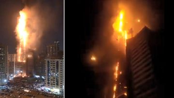 A massive fire burns at the 48-floor Abbco Tower in Sharjah, UAE.