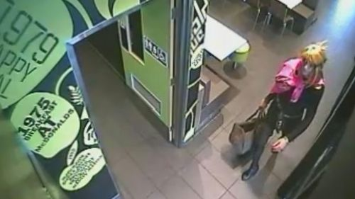 High heeled and dangerous: bandit on the run after bizarre robbery