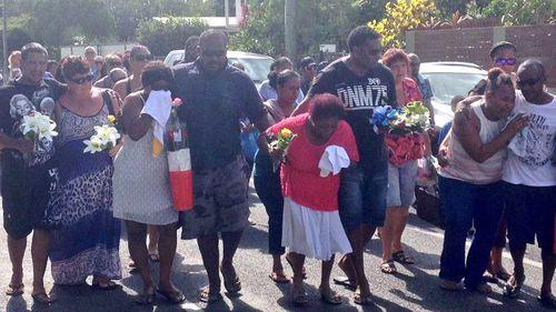 Family members arrive at the Manoora shrine in Cairns. (Tom Steinfort)