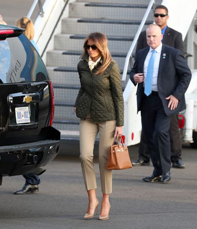 Melania Trump in a Burberry coat, Michael Kors trousers and Hermes scarf in Ayrshire Scotland, July 2018