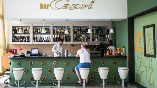 A customer sits at the lobby bar of the Hotel Capri in Havana, Cuba. (AP)