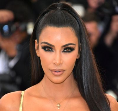 "Despite the unofficial title of being 'The Oscars of fashion', the Met Gala is equally about the boldest and bravest beauty looks. <br> <br> Case in point, Kim Kardashian West.<br> <br> The reality star made a (fashionably) late entrance at this year's celebration <em><a href=""https://style.nine.com.au/2018/05/08/08/05/met-gala-2018"" target=""_blank"" draggable=""false"">'Heavenly Bodies: Fashion and the Catholic Imagination'</a></em>, clad in a show-stopping fitted gold gown courtesy of Atelier Versace.<br> <br> Mrs West's gown may have had the Midas touch, but it was her beauty look that stole the show. <br> <br> While the mother-of-three never fronts up without a full face, this time she took her glam to the next level with the help of her go-to makeup artist, Mario Dedivanovic.<br> <br> Using an array of products from Kardashian's own makeup range, KKW Beauty, he used a mixture of eyeshadows, a brightening powder, crème contour sticks in two different shades, a highlighter and smouldering brown lipstick to give the beauty mogul a '90s supermodel-inspired look.<br> <br> Get the full breakdown of the mother-of-three's beauty look at Dedivanovic's Instagram page @makeupbymario.<br> <br> Click through to see the other stars that put their best face forward at this year's Met Gala."