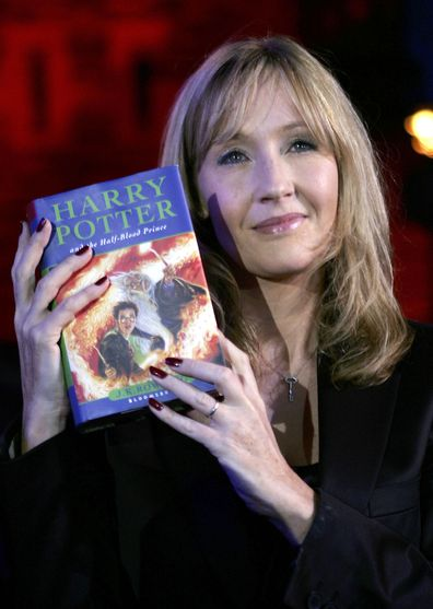 JK Rowling holding a Harry Potter book