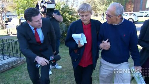 Ms Bodnar dodging questions from waiting media. (9NEWS)