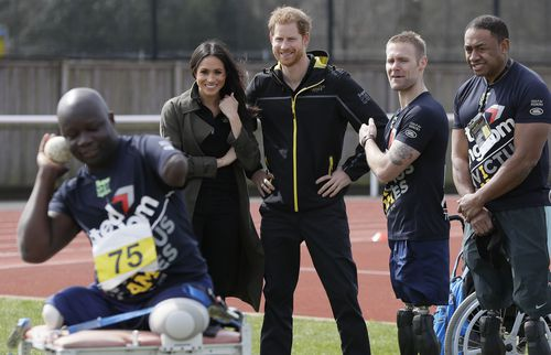 Prince Harry and his fiancee Meghan Markle meet athletes at the UK team trials for the upcoming Invictus Games Sydney 2018. (AAP)