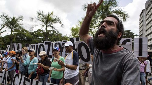 Protesters line the streets of Caracas, Venezuela. (AAP)