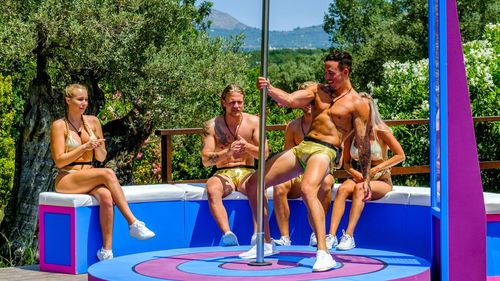The reality show featured fit people on a hot island in swimwear performing stunts like this. Picture: 9