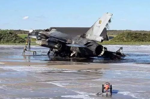 The burnt-out Belgian Air Force F-16 after it was accidentally hit by cannon fire at Florennes Air Base in the country's south.