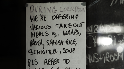 A takeout menu is seen in the window of a restaurant in Newtown on May 07, 2020 in Sydney, Australia. (Photo by Jenny Evans/Getty Images)