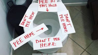 Pee here: Kristina covered her toilet in notes to help stop toilet mess.