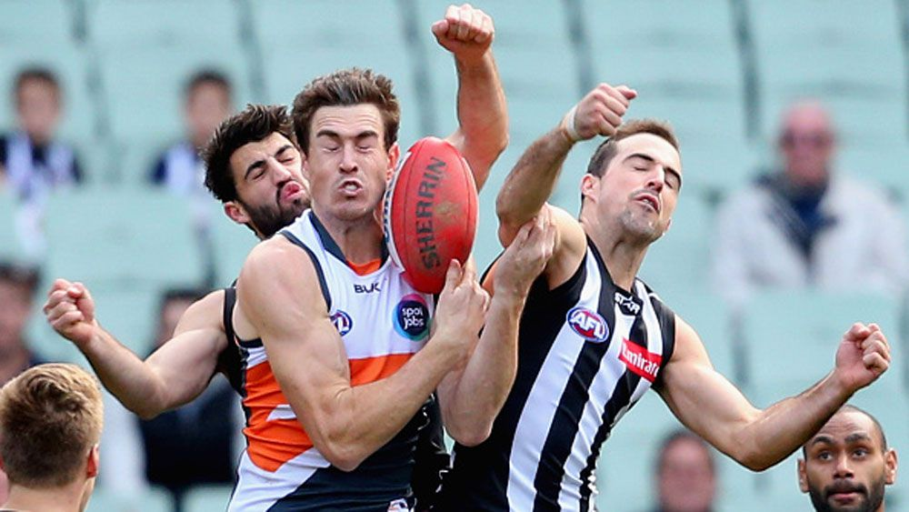 Giants star Jeremy Cameron attempts to take a mark in front of Collingwood's Steele Sidebottom. (Getty)