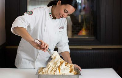 Anna Temellini, product innovation specialist for Gelatissimo. Woman scooping gelato