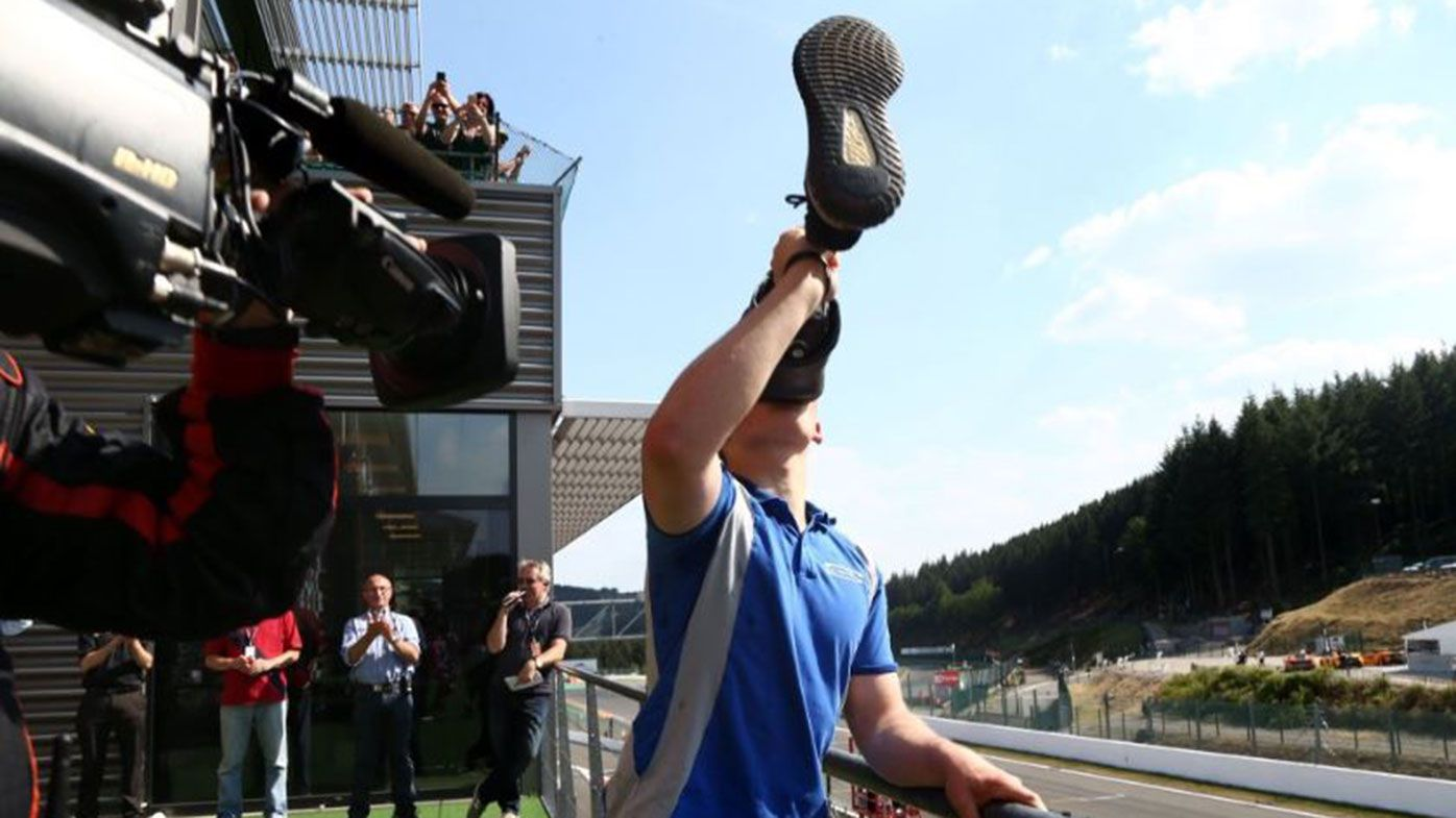 """Billy Monger celebrates on the podium with a """"leggy"""""""