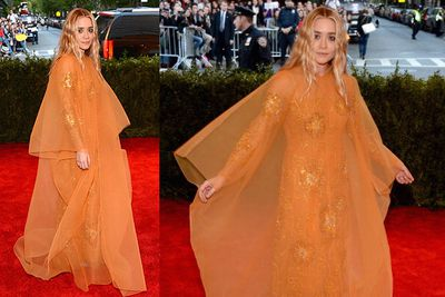 Ashley Olsen rocks a fluro orange gown at the Met Gala in NYC.