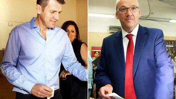 Mike Baird and Luke Foley vote in the 2015 NSW state election. (AAP)