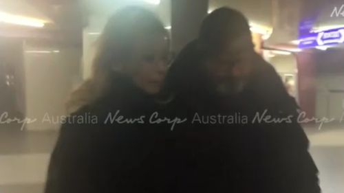 The fugitive was spotted with his new girlfriend outside a cinema. (NewsCorp)