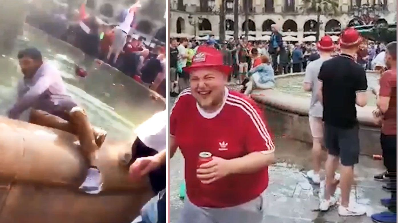 Liverpool fans laugh at pushing locals and tourists into a Barcelona fountain