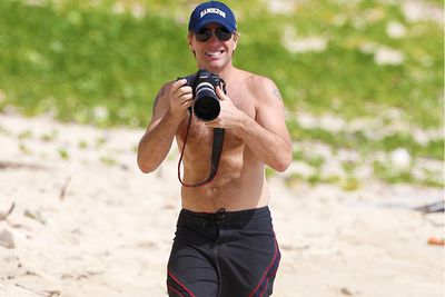 Bon Jovi gives the paps a taste of their own medicine while taking a walk along the beach in St Barts.