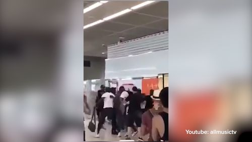 Two French rap stars have been fined after starting a brawl at Paris Orly Airport.
