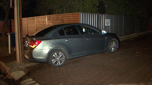 The car struck a gas pipe when the driver allegedly tried to flee.