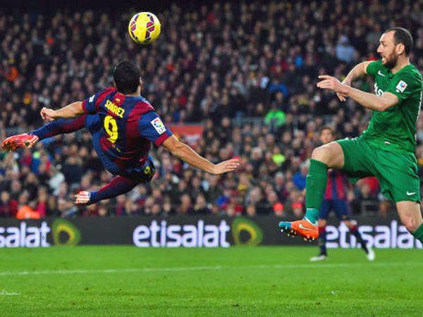 Messi scores hat-trick, Suarez steals show