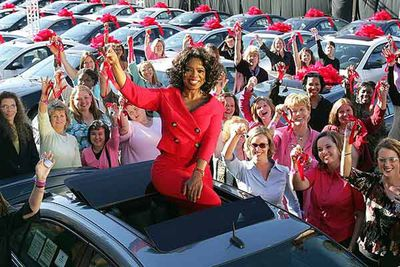 Oprah celebrated the beginning of her 19th season in spectacular fashion, with a US$7 million car giveaway, surprising everybody in the audience with a new car: 276 mid-size Pontiac G6s fresh off the assembly line, each worth US$28,400. In 2010 she managed to top it, giving away a car that hasn't even been assembled yet, the 2012 VW Beetle.