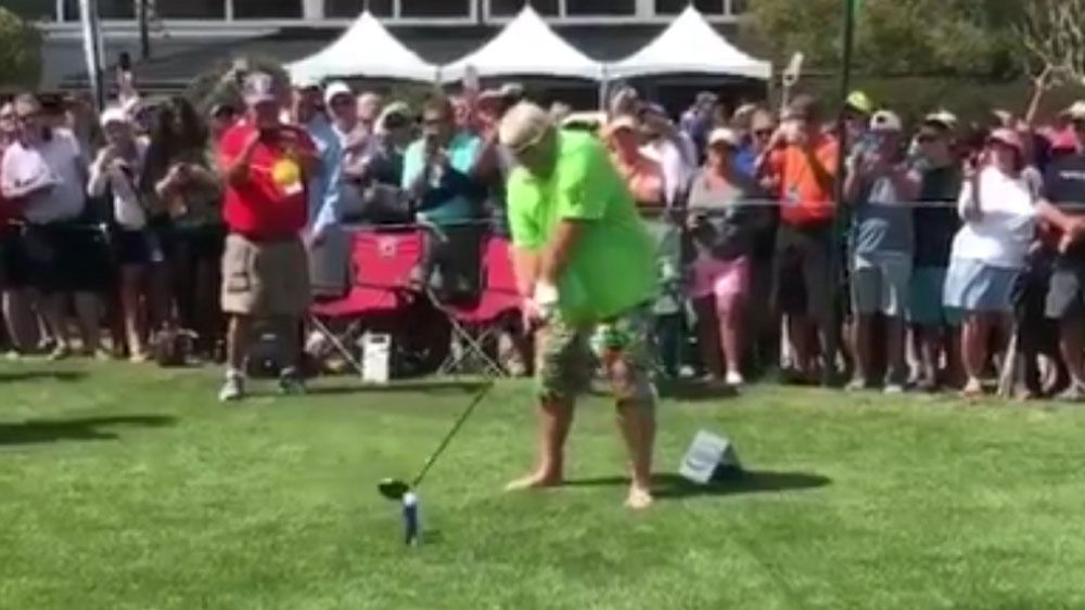 American golfer John Daly smokes and chugs a beer at celebrity Pro-Am