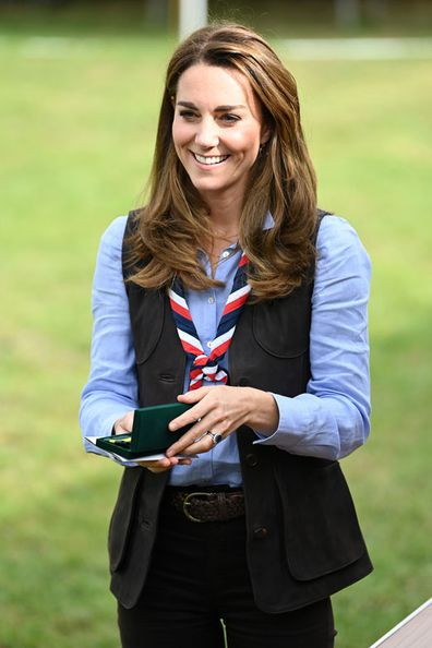 Duchess of Cambridge reacts as she receives the Silver Wolf Award medal during her visit to a Scout Group in Northolt, northwest London where she joined Cub and Beaver Scouts in outdoor activities on September 29, 2020 in London, England