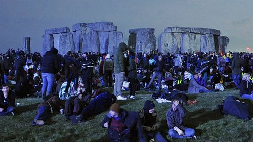 Revellers await the dawning of the summer solstice at the historic world heritage site of Stonehenge. (AAP)