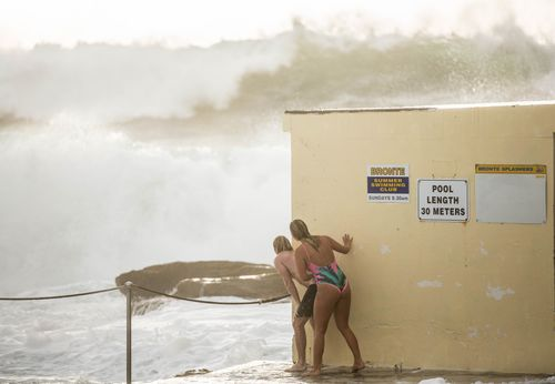 Brave beachgoers daring enough to face the strong swell were faced with offshore waves of up to nine metres in height (AAP).