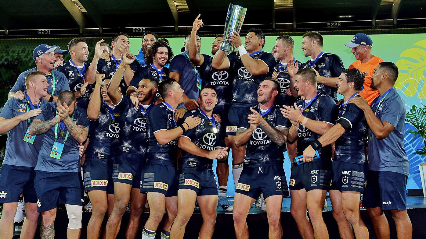 The Cowboys celebrate after winning the Final against the Dragons