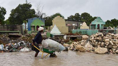 A wheelbarrow full of possessions in Haiti. (AP)