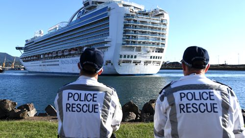 NSW Police Rescue officers look on as the Ruby Princess, with 1040 crew on board, docks at Port Kembla, Wollongong