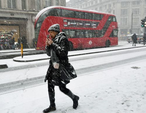 A pedestrian braves the snow in Oxford Street, central London. (AP).
