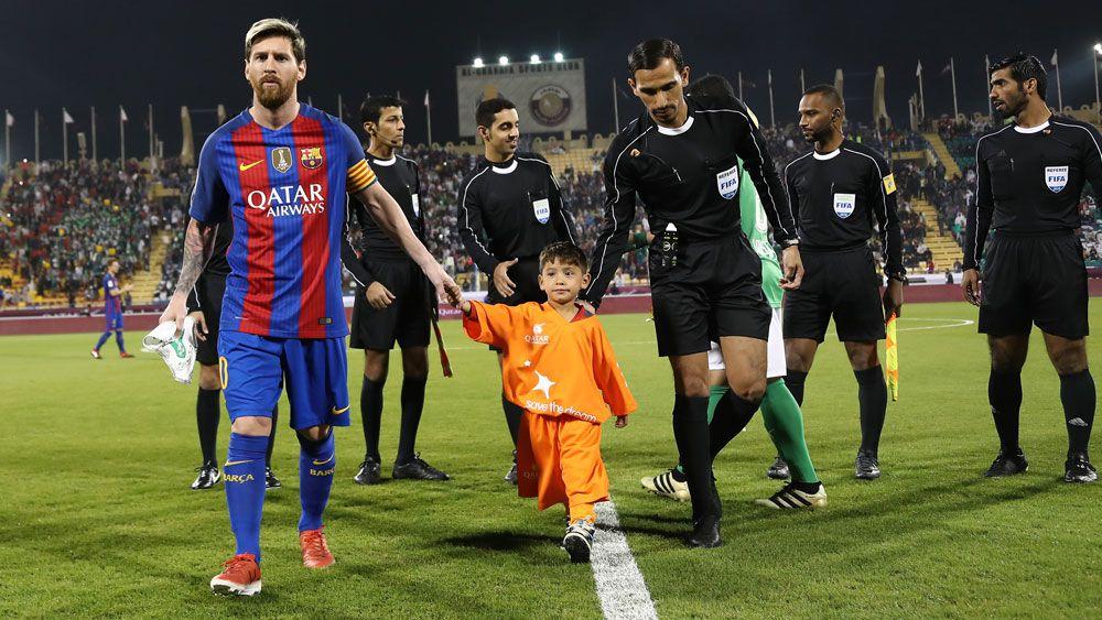 Boy in the bag meets hero Messi