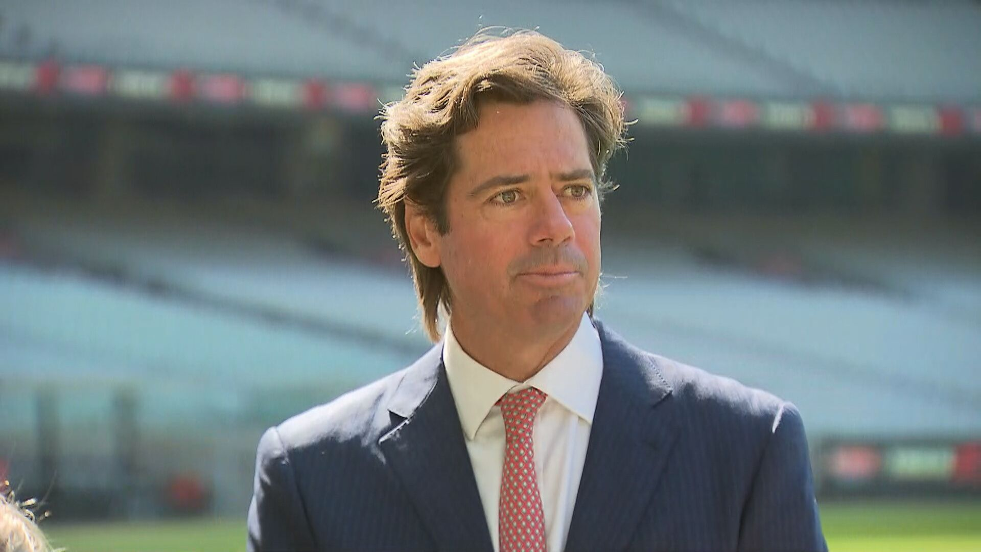 Return to big crowds at AFL could be a slow build, says Gillon McLachlan