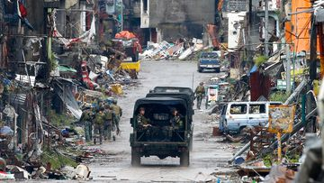 Troops patrol the decimated streets of Marawi city in southern Philippines in 2017 after almost five months of the siege by pro-Islamic State group militants.