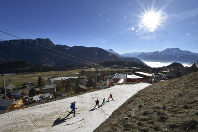 December 28. 2016 - Skiers descend towards Swiss ski resort Leysin on a thin layer of snow during the warm December. (AFP/Fabrice Coffrini)