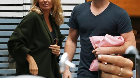 Lara Bingle and Sam Worthington's tell-tale hint at 'secret marriage': Look what they're wearing on their ring fingers!