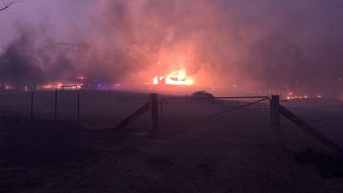 Firefighters worked overnight to protect a number of properties in coastal communities around Shoalhaven.
